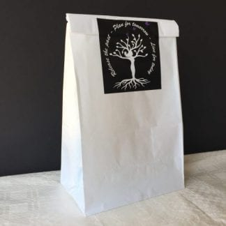 A photo of a sealed white paper bag